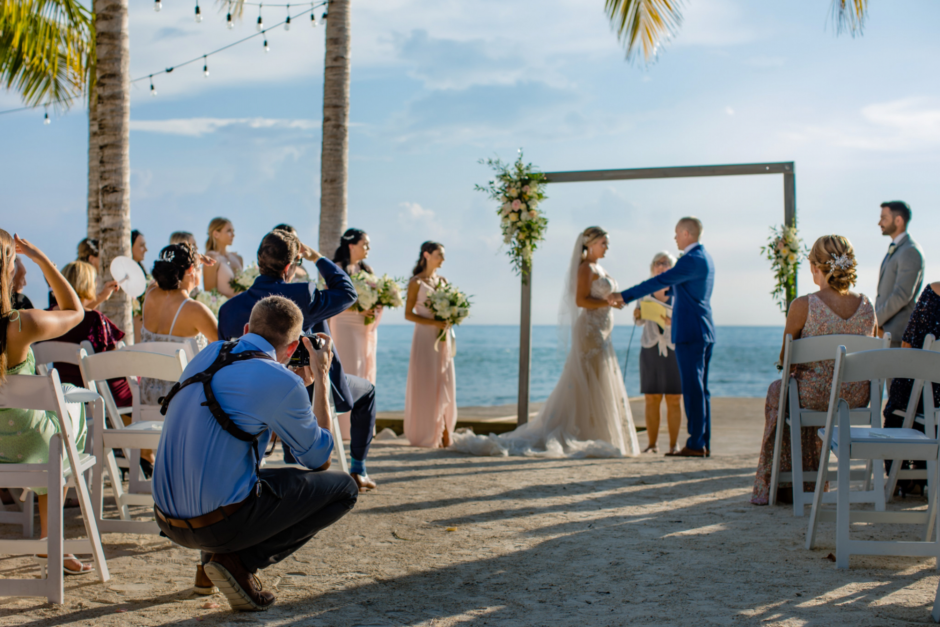 Asheville wedding photographer Michael Freas at work at a North Carolina beach ceremony