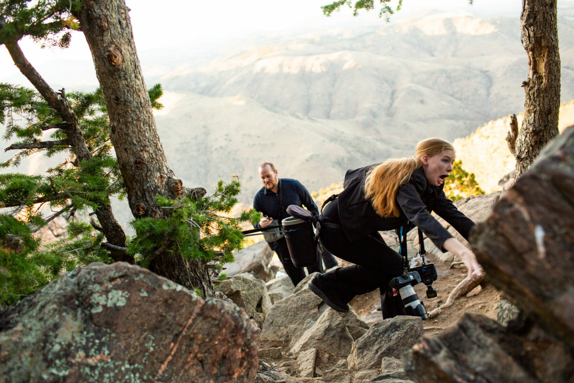 The Colorado wedding photographer's belt gets stuck on a tree branch