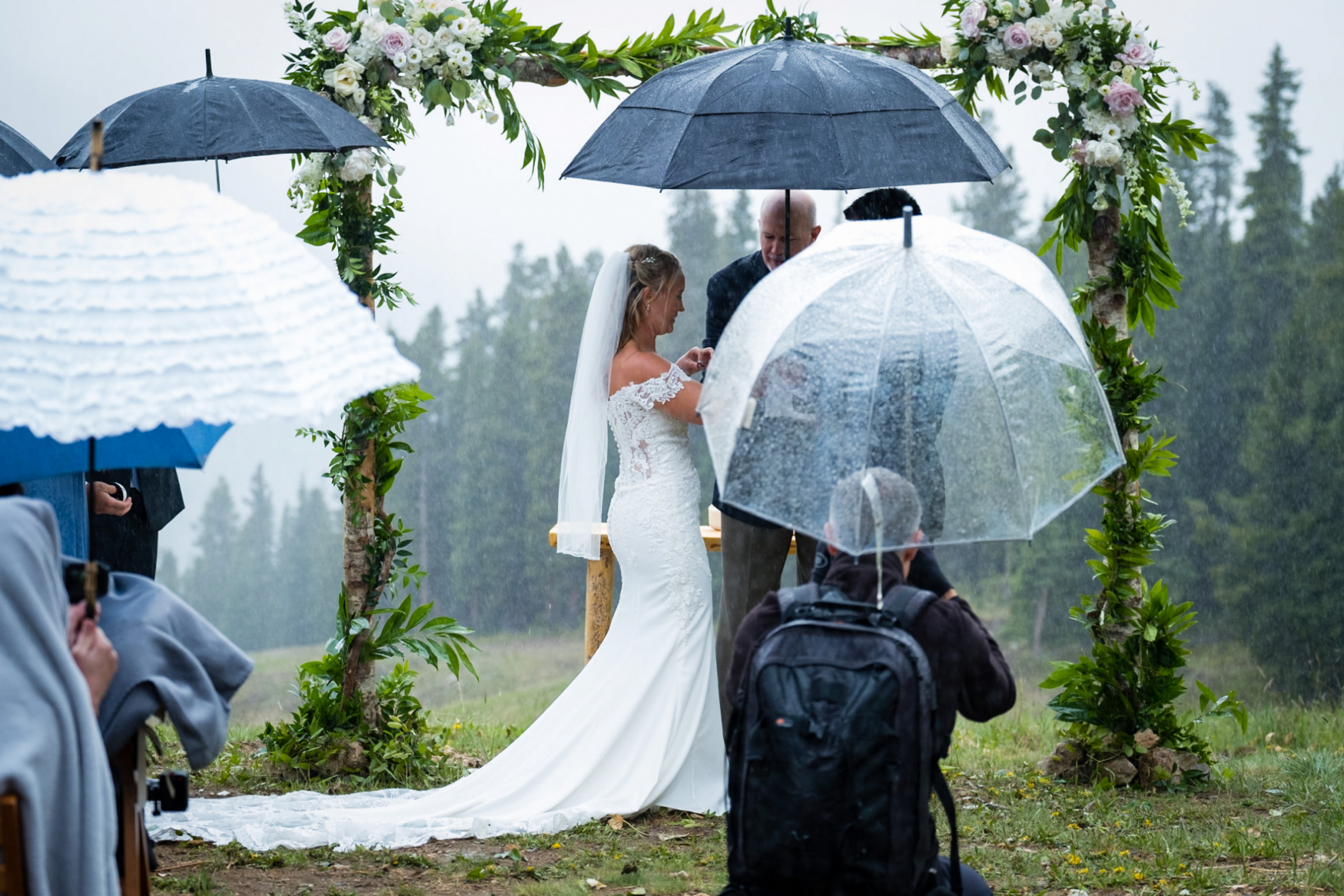 Colorado Wedding photographer Mark Creery working at a ceremony in the rain in Fort Collins