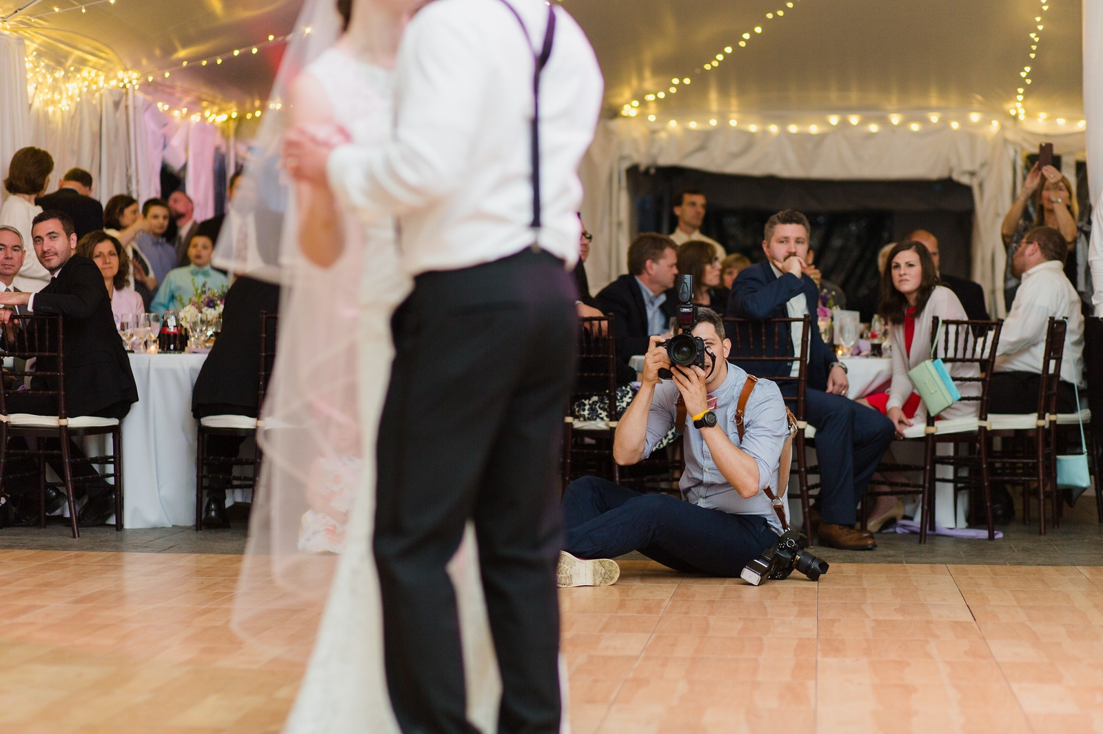 Documentary Wedding Photographer Stephen Grigoriou, in the field at work on the dance floor
