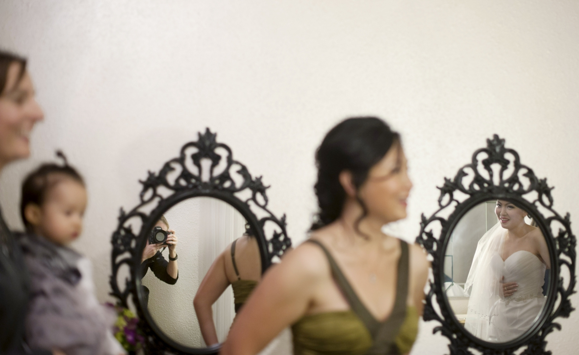 Laura Segall, an AZ wedding photographer, caught her own reflection at an event