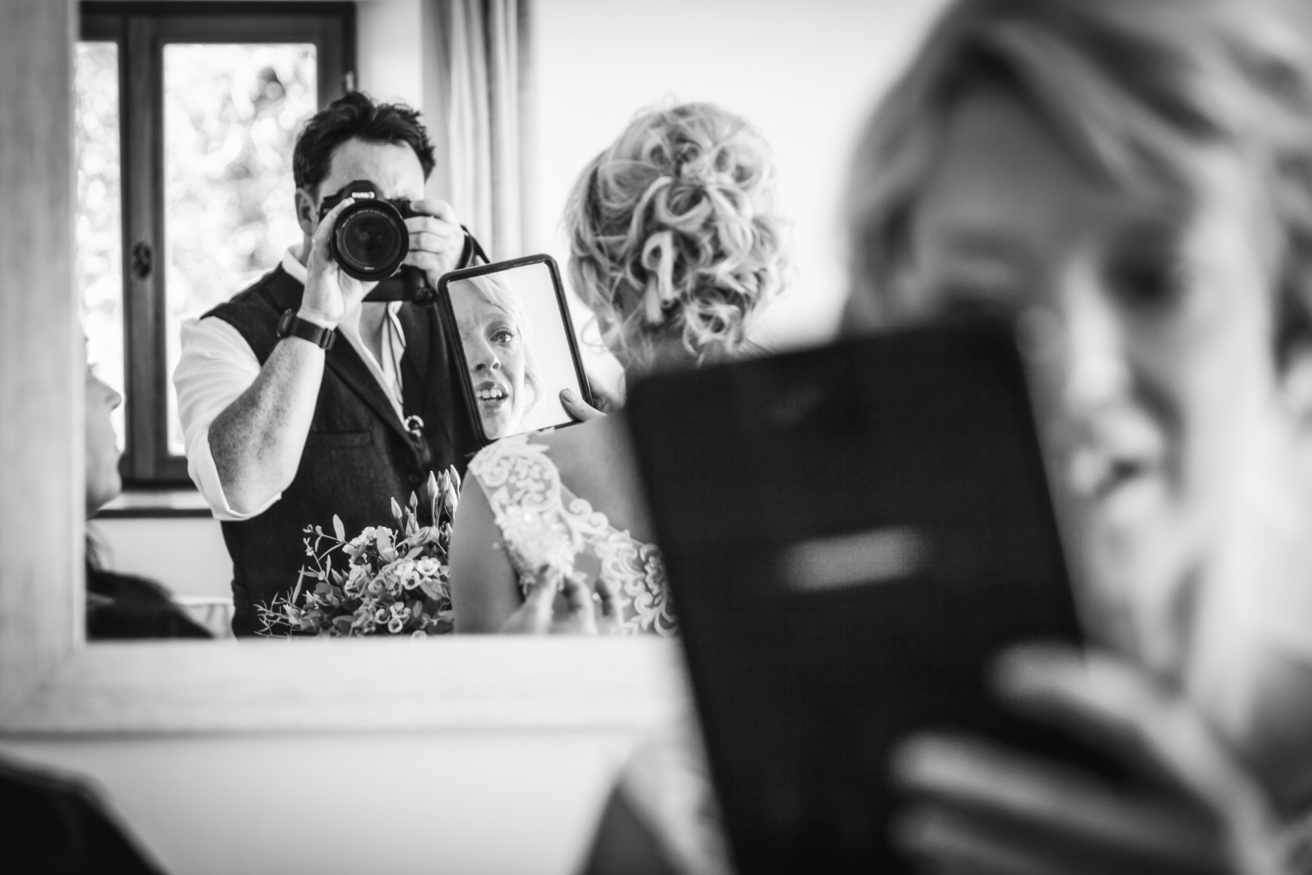 Neil Pleasants taking pictures of a bride at a wedding