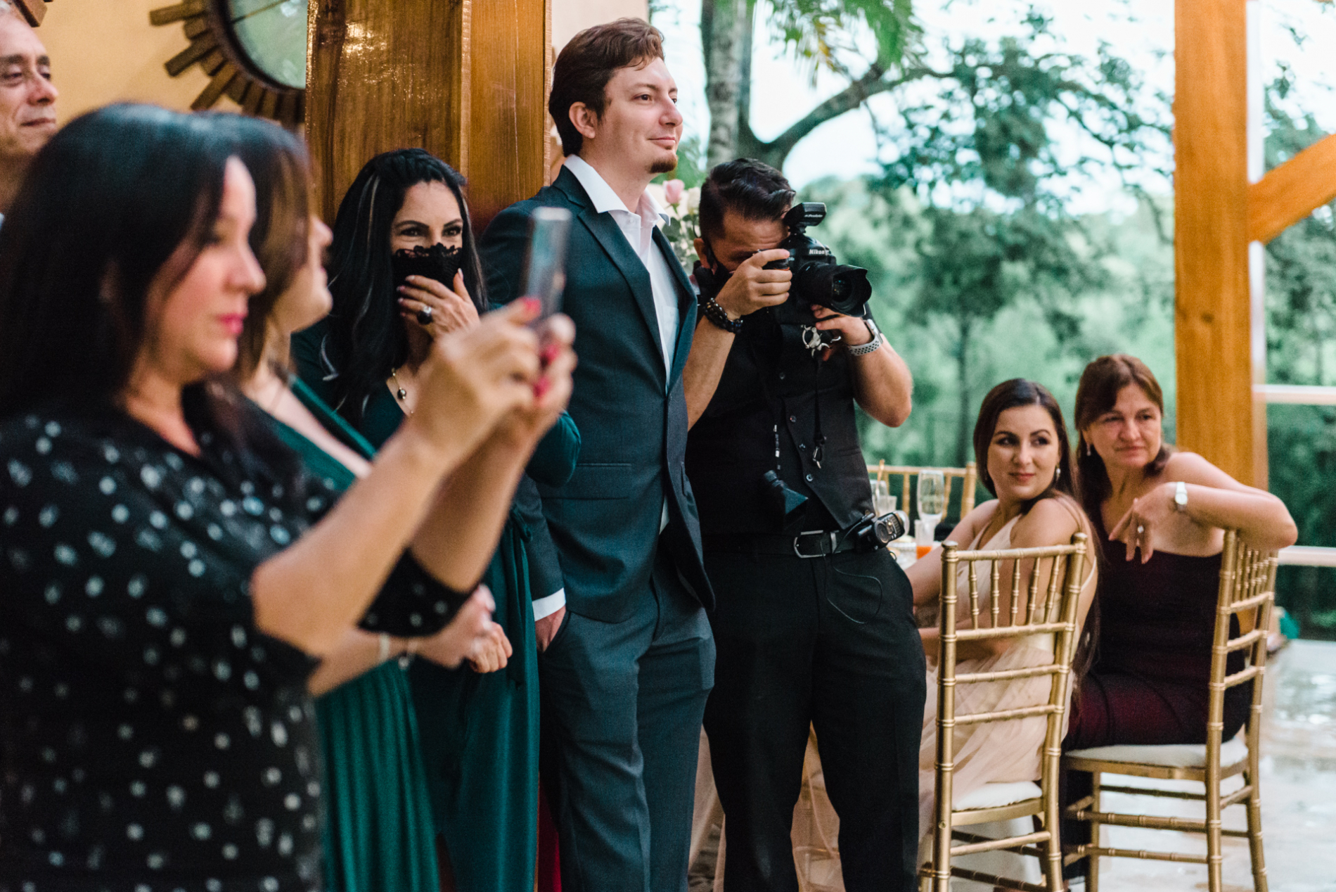 San Jose-CR wedding photographer working an event with camera in Costa Rica