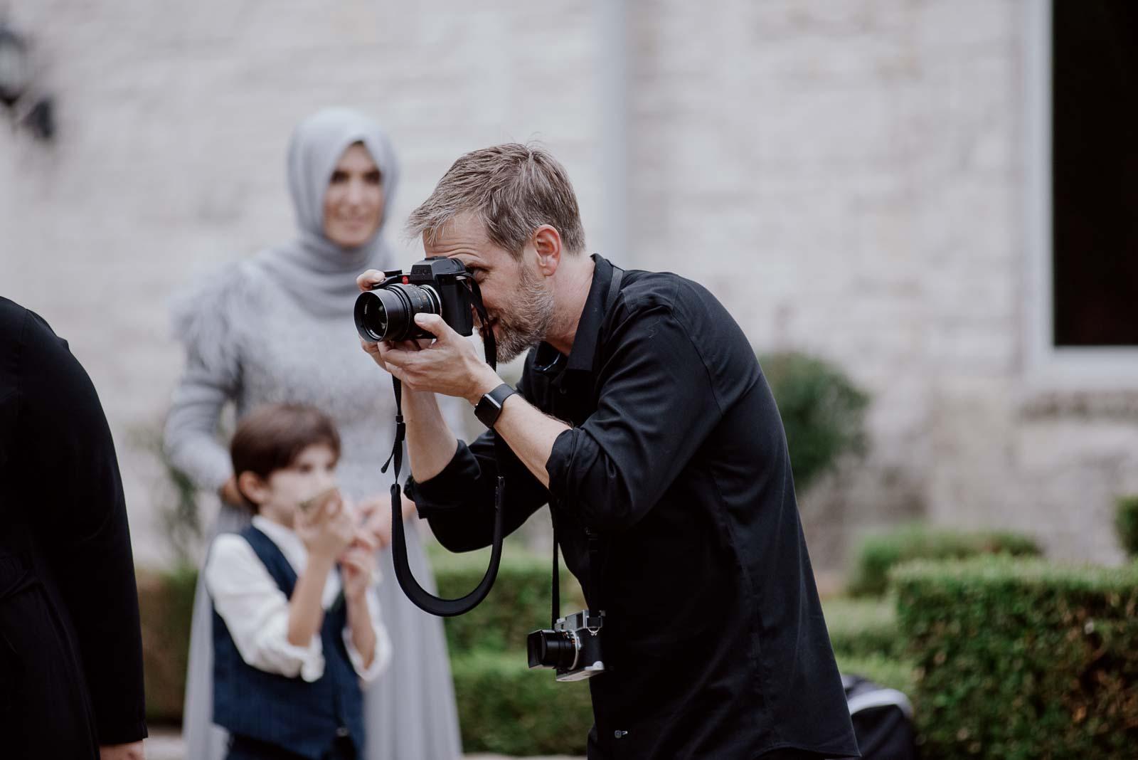 Philip Thomas, wedding photographer, making images on location at Briscoe Manor, Texas
