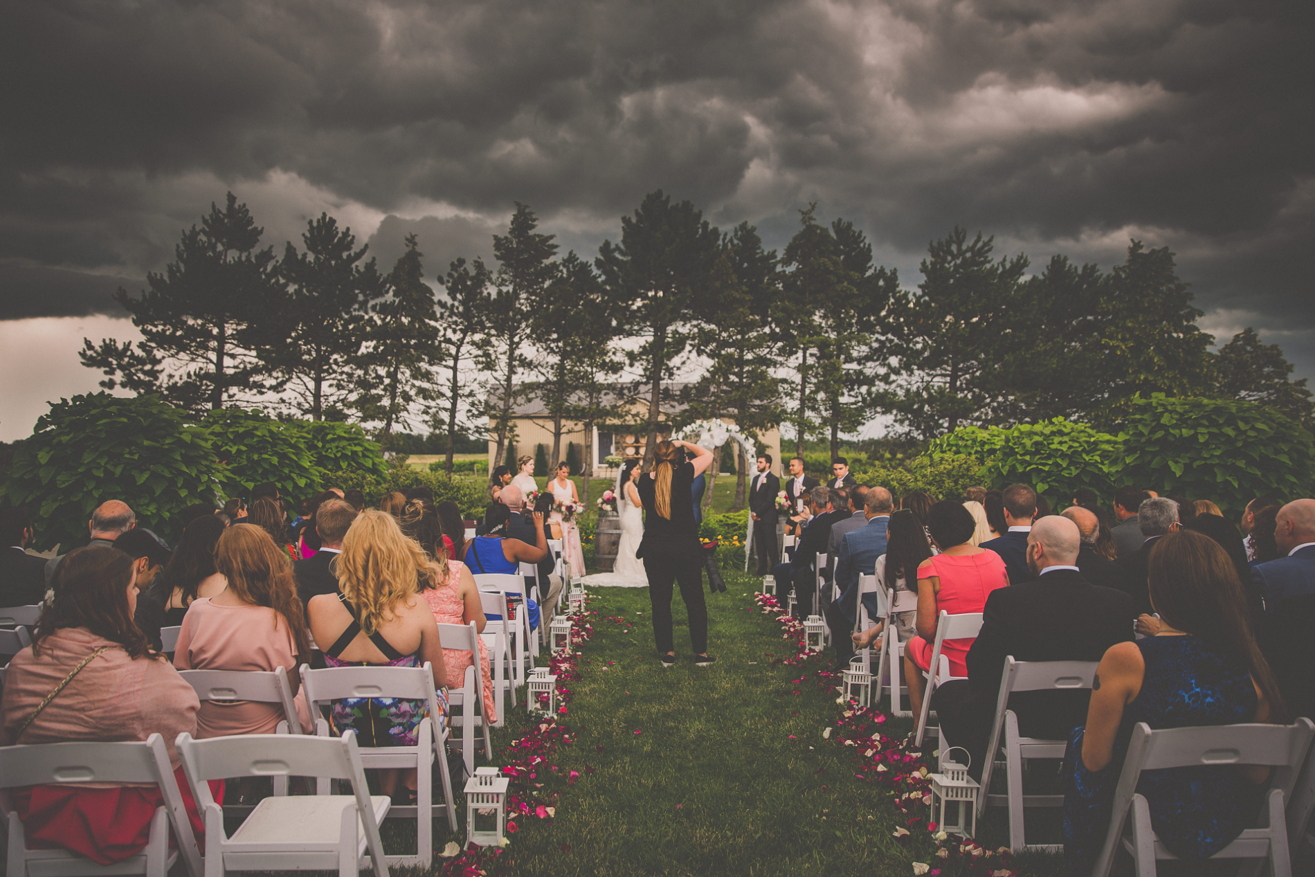 Ontario, Canada storm cloud looming over wedding ceremony photographer