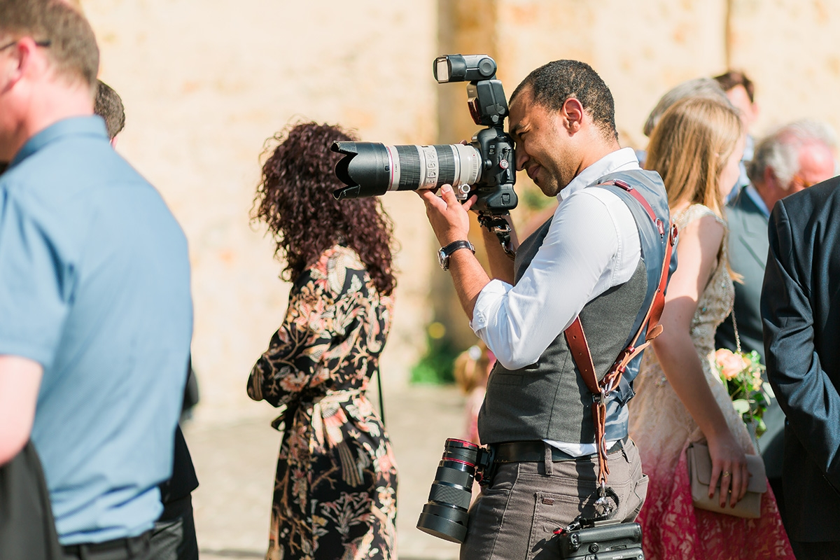 France destination wedding photographer Jeremie Sangare at work during a wedding