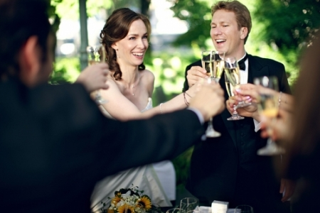 Wedding toast photography with bride and groom during reception.