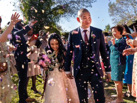 Hertfordshire wedding photo of confetti tossed at Minstrel Court, North Road, Royston, Hertfordshire, UK