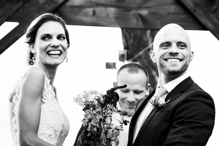 Happy, smiling bride and groom during their outdoor wedding ceremony at the Shupe Homestead | Boulder Wedding Photographer