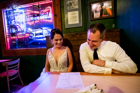 Colorado bride and groom eating dinner at a restaurant bar venue after elopement
