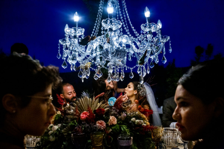 bodrum turkey wedding photography of the bride under the lights at macakizi