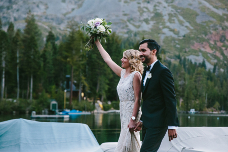 Couple celebrating wedding post-ceremony by the lake at Fallen Leaf Lake, South Lake Tahoe, CA