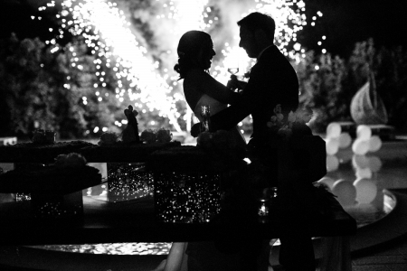 Cervia, Ravenna, Italy - Photo of the bride and groom toasting with fireworks.