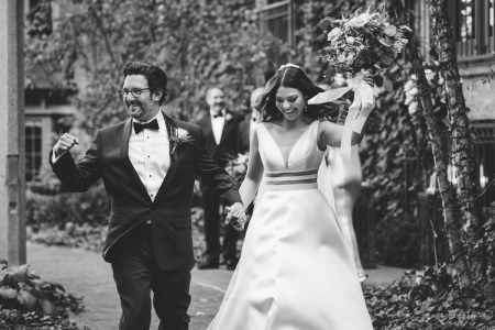 The Ivy Room Chicago, IL wedding day image in black and white of the bride and groom walking outdoors