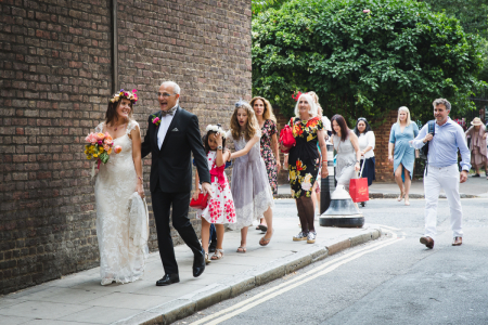 Image of the bridal party walking near the venue of Phoenix Garden, London, United Kingdom