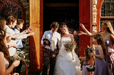 colnera south africa wedding celebration image of the bride and groom under thrown rice