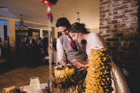 St Ekaterina Hotel Wedding Photography of cake cutting couple | Ribaritsa, Bulgaria