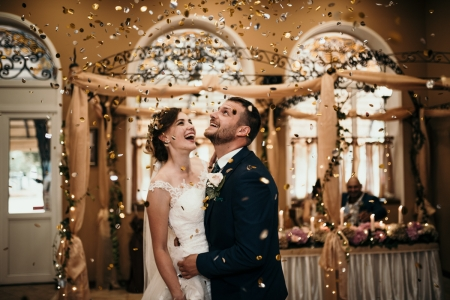 Confetti flies over the bride and groom at the Restaurant Drakata | Wedding Photography in Lovech, Bulgaria