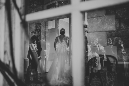 Boğaziçi Üniversitesi Kennedy Lodge, İstanbul wedding picture of the bride with glass reflections.
