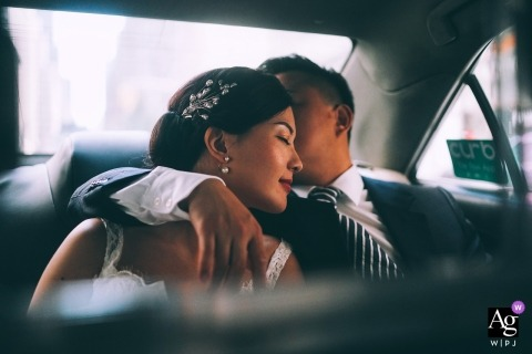New York Artistic Wedding Portrait of Bride and Groom in Taxi
