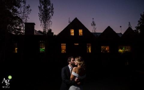 Rio Grande du Sol Wedding Photography and Portraits | Image contains: portrait, bride, groom, kissing, outdoors, sunset, dress, suit