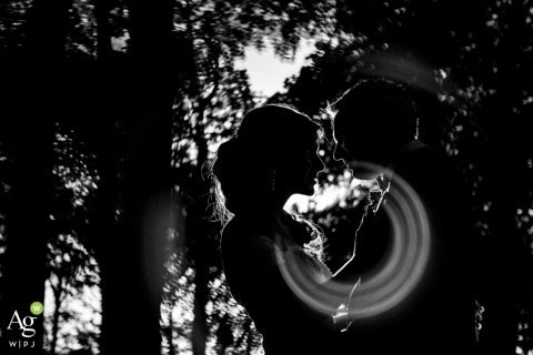 Lyon Wedding Photo | Image contains: black and white, silhouette, portrait, bride, groom, trees, embrace