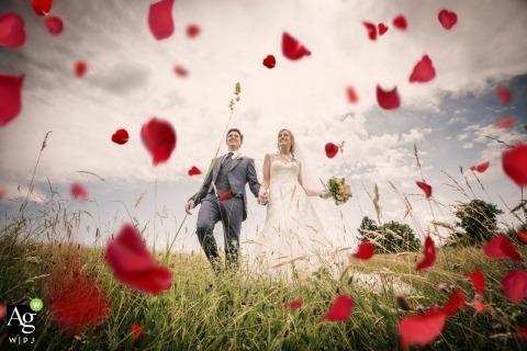 Venice Wedding Photographer for Portraits | Image contains: bride, groom, petals, meadow, holding hands, bouquet, dress, suit
