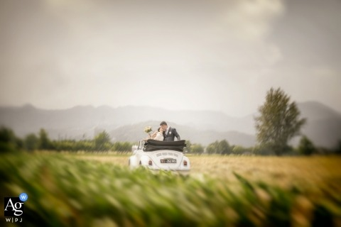 Vicenza Artistic Wedding Photo | Bride and Groom Portrait with VW convertible in field of grass