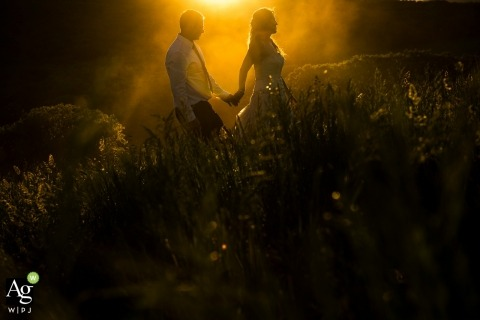 White Owl Ranch Wedding | Colorado Wedding Photograph of Bride and Groom Walking in afternoon sunlight