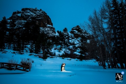 Black Canyon Inn Wedding | Estes Park Wedding Photo Portrait with bride and groom in the snow