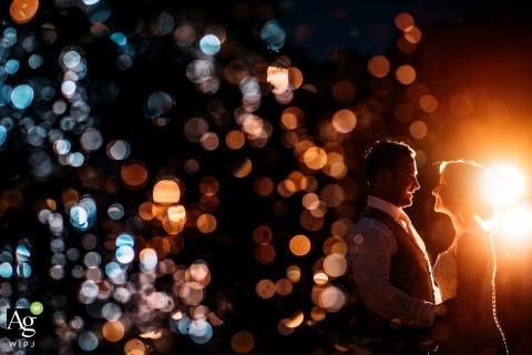 bride and groom wedding day portrait by a fountain at night