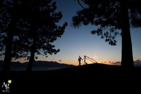 Lake Tahoe Wedding Photo of Bride and Groom walking at Sunset