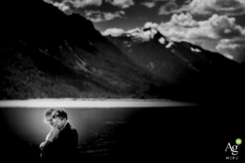 Seattle Wedding Photos | Image contains: black and white, groom, bride, embrace, portrait, mountain, lake, sky