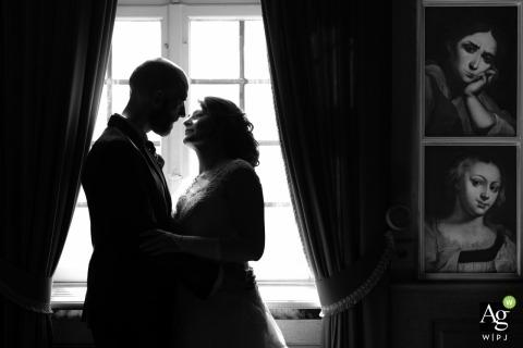 Offenburg Wedding Photo | Image contains: black and white, groom, bride, embrace, portrait, art, window