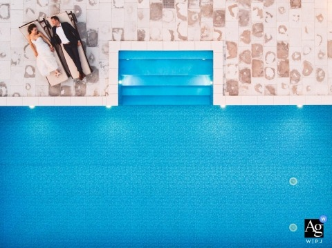 slovenia drone portrait by the pool | Artistic Wedding Photo of Bride and Groom