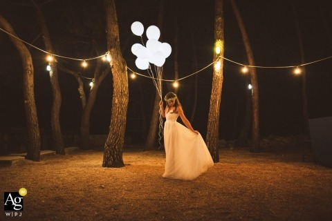 Slovenia bride with balloons | portrait in the trees on wedding day