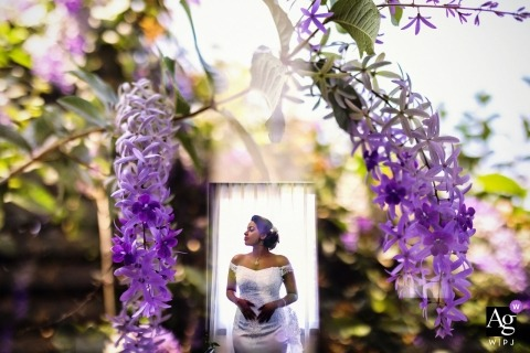 Sri Lanka bridal portrait with purple flowers and white background