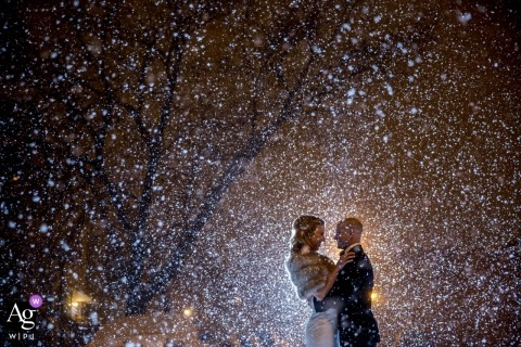 Chicago bride and groom outside in falling snow for a wedding day portrait