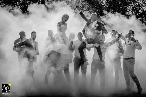 Zuid Holland Wedding Photography | Image contains: bride, groom, groomsmen, black and white, smoke, portrait, celebration, drinks