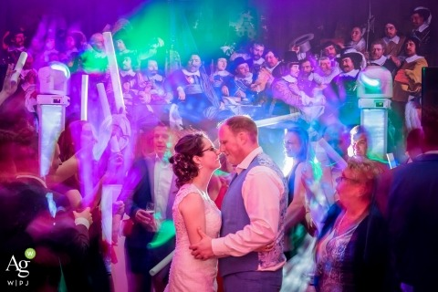 Zuid Holland Documentary Wedding Photographer | Image contains: bride, groom, reception, party, lights, dancing, wedding guests, portrait
