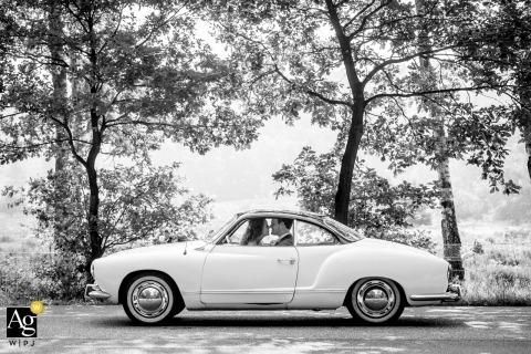 Zuid Holland Artistic Wedding Portrait of Bride and Groom inside Karmann Ghia, VW