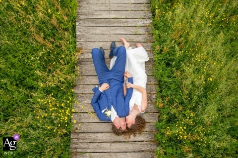 Zuid Holland Artistic Wedding Photo of Bride and Groom on Boardwalk from Overhead