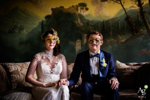 Florence Wedding Photography | Image contains: bride, groom, masks, holding hands, portrait, dress, suit