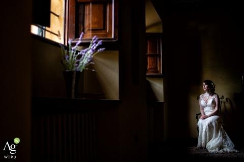 Florence Wedding Photographer | Image contains: flowers, bride, dress, sunlight, shadows, portrait