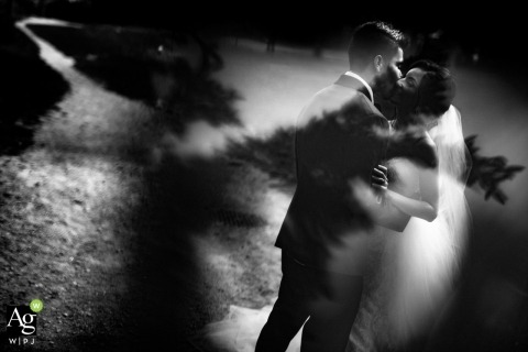 Ontario Wedding Photography | Image contains: bride, groom, black and white, shadow, reflection, embrace, dress, suit