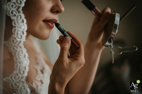Lovech Wedding Photojournalism | Image contains: bride, make-up, getting ready, detail shot, veil, mirror, lipstick