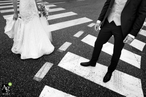 French wedding photographer in Annecy Alps - Bride and Groom detail in roadway crosswalks