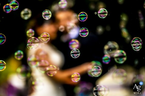 Lecco creative wedding photography | detail of bride and groom with bubbles in the foreground