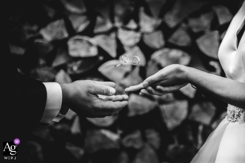Lille creative wedding photography | detail of bride and groom tossing up their rings