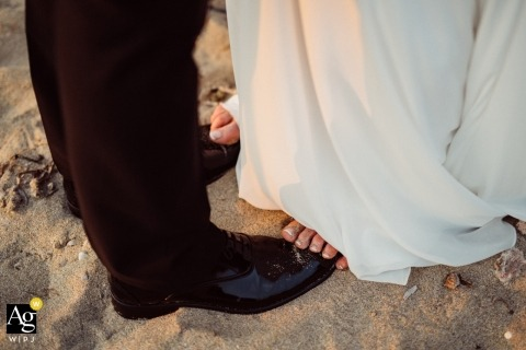Sicily artistic wedding photography details | bride's bare feet on top of groom's in the sand